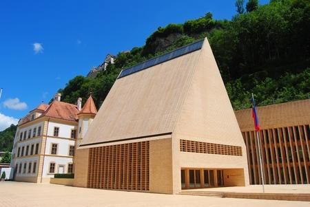 parliament building: Vaduz, Liechtenstein - July 14, 2014. The Parliament building in Vaduz, with surrounding buildings, in summer.