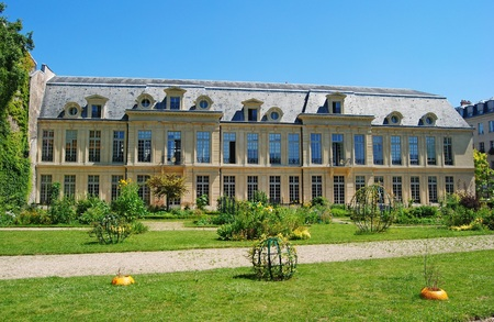 Paris, France - July 2, 2014. Hotel dAumont building in Paris, with grass lawn and vegetation. Editorial