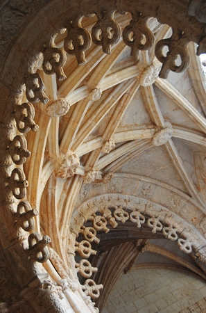 scalloped: Lisbon, Portugal - October 21, 2014. Delicately scalloped arches of Manueline cloisters of Mosteiro des Jeronimos in Lisbon.