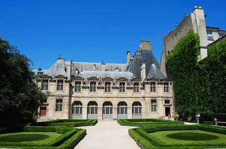 Paris, France - July 2, 2014. Hotel de Sully mansion in Paris, with grass lawn and people.