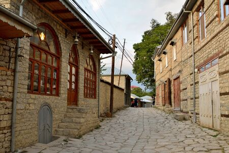 azeri: Lahic, Azerbaijan – August 11, 2017.  Street view on cobblestone Huseynov street, the main street of Lahic mountainous village of Azerbaijan, with buildings and people.