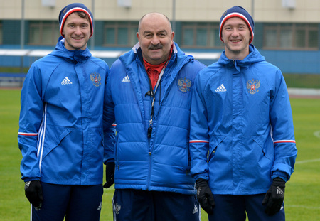 Moscow, Russia - October 5, 2017. Russian international football team manager Stanislav Cherchesov with Miranchuk twin brothers in Moscow.