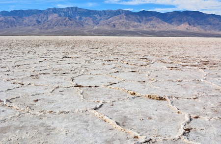 Crinkly salt flats of constantly evaporating bed of salty, mineralized water at the Badwater Basin in the Death Valley National Park in USA.