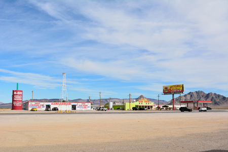 Amargosa Valley, Nevada, United States of America - November 24, 2017. Desert truck stop in Amargosa Valley with Area 51 Alien Center, commercial properties, petrol station and cars.