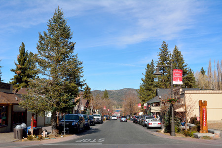 Big Bear Lake, California, United States of America - December 2, 2017. View of main street, Pine Knot Avenue, in Big Bear Lake, with buildings, cars and trees. Editorial