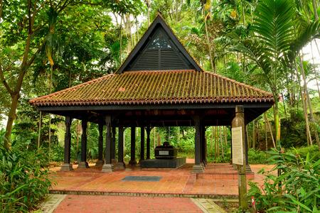 Singapore, Singapore - December 11, 2017. Tomb of Keramat Iskandar Shah at Fort Canning in Singapore, with vegetation. Editorial