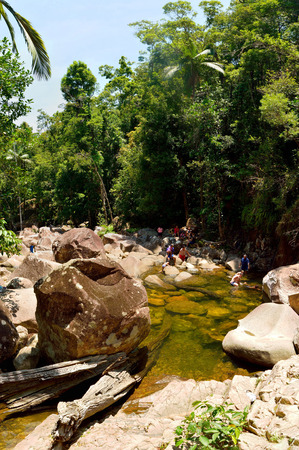 Eungella, Queensland, Australia - January 1, 2018. Swimming hole at Araluen Falls in Eungella National Park in Australia, with people, boulders and vegetation.