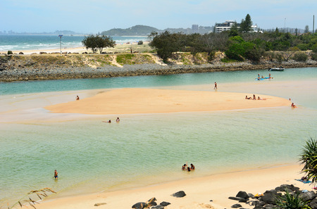 Burleigh Heads, Gold Coast, Queensland, Australia - January 13, 2018. View of Tallebudgera Beach and creek with people.
