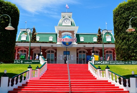 Coomera, Queensland, Australia - January 9, 2018. Exterior view of entrance to Dreamworld theme park, with stairs, building and people.
