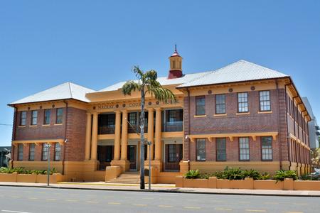 Mackay, Queensland, Australia - December 28, 2017. Historic Mackay Court House in Mackay QLD, with vegetation.