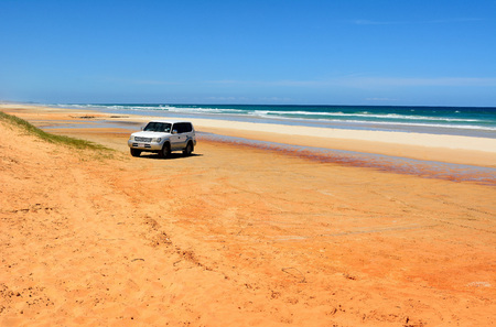 Great Sandy National Park, Queensland, Australia – December 19, 2017. 40-mile beach in Great Sandy National Park, QLD with 4WD Toyota Prado vehicle parked on sand.