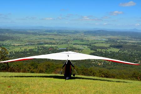Hang-glider taking off a mountain top in Australia. Editöryel