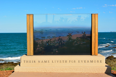 Emu Park, Queensland, Australia -  December 27, 2017. Their Name Liveth for Evermore Anzac Memorial at beach front in Emu Park, Queensland, Australia, with battle scene painting on glass against ocean background.