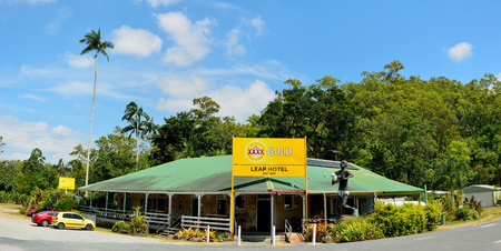 The Leap locality, Queensland, Australia - December 31, 2017. Exterior view of historical Leap Hotel, dating from 1886, with statue of Aboriginal Kowaha woman, billboard, cars and vegetation in the Leap locality in Queensland. Editöryel