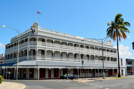 Rockhampton, Queensland, Australia - December 28, 2017. Historic building dating from 1898, occupied by Heritage Hotel, on the corner of Quay and William Streets in Rockhampton, QLD, with car and vegetation. Editöryel