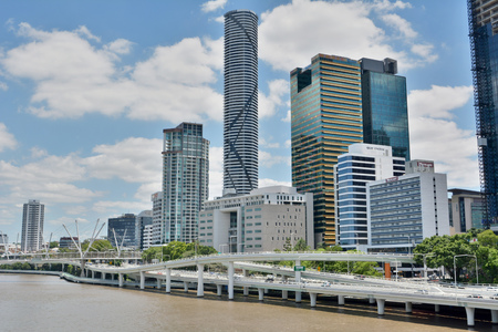 Brisbane, Queensland, Australia -  January 6, 2018. View of river waterfront in Brisbane with modern commercial and residential buildings, motorways and bridges.