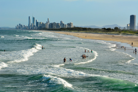 Main Beach, Gold Coast, Queensland, Australia - January 10, 2018. Beach at the Spit, with people and skyscrapers of Surfers Paradise in the distance. Editöryel