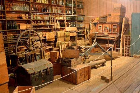 Maryborough, Queensland, Australia - December 21, 2017. Interior view of Brennan and Geraghty Store museum in Maryborough, QLD, with old furniture, shelves of bottles and tins, boxes and cases. Editöryel