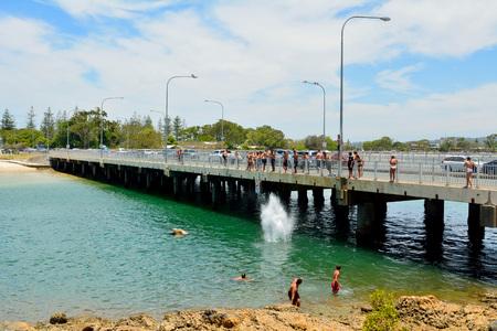 Burleigh Heads, Gold Coast, Queensland, Australia - January 13, 2018. Bridge across Tallebudgera Creek in Burleigh Heads, with people.
