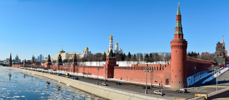 Moscow, Russia – March 18, 2018. View of Kremlin fortified complex in Moscow, the seat of the Russian Government, with walls, towers and historic buildings, street traffic and people.