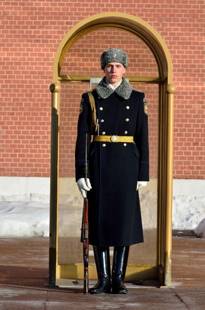 Moscow, Russia - March 20, 2018. Russian solder of the Kremlin Regiment maintaining guard of honor at the eternal flame of the Tomb of the Unknown Soldier in Moscow. Editöryel