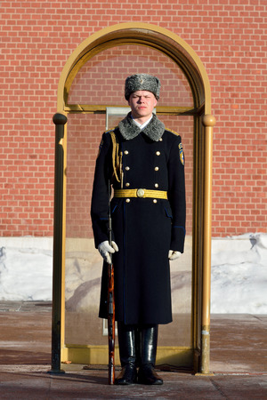 Moscow, Russia - March 20, 2018. Russian solder of the Kremlin Regiment maintaining guard of honor at the eternal flame of the Tomb of the Unknown Soldier in Moscow. Editorial