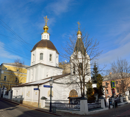 Moscow, Russia - March 19, 2018. Exterior view of the Church of the Small Ascension on Bolshaya Nikitskaya street in Moscow, with surrounding buildings. The church is dating to the 17th century. Editorial