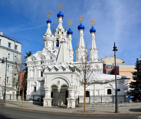 Moscow, Russia - March 19, 2018. Exterior view of the Church of the Nativity of the Virgin in Putinki in Moscow, dating from 1652. View with surrounding buildings. Editorial
