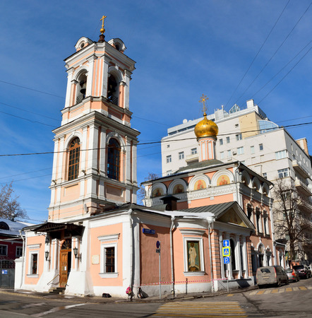 Moscow, Russia - March 19, 2018. Church of the Resurrection on Bryusov lane in Moscow, was one of the few churches to remain open during Soviet period. View with surrounding buildings.