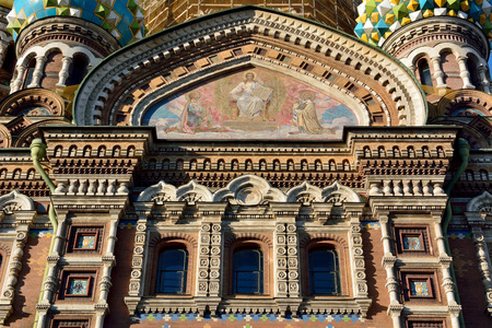 St Petersburg, Russia - March 26, 2018. Details of exterior design of the Church on the Spilled Blood in St Petersburg, with mosaics, domes, windows and decorative elements.