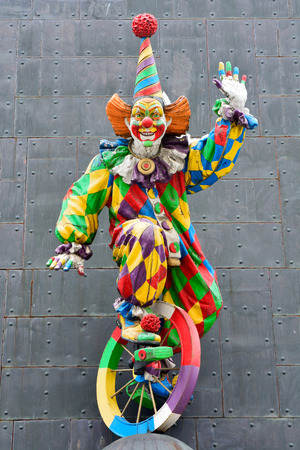Moscow, Russia - March 22, 2018. Colorful sculpture of clown on the facade of Tsereteli museum building in Moscow.