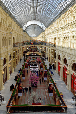 Moscow, Russia - March 17, 2018. Interior view of GUM department store on the Red Square in Moscow, with people. Editorial