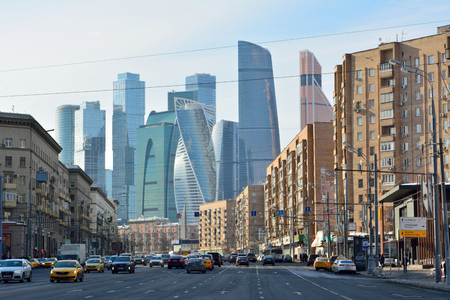Moscow, Russia - March 17, 2018. Street view on Bolshaya Dorogomilovskaya street in Moscow, with skyscrapers of Moscow City, residential buildings, commercial properties, street traffic and people. Editorial