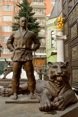 Moscow, Russia - March 22, 2018. Statue of Vladimir Putin in judo costume, with tiger at his feet, in the courtyard of Tsereteli museum in Moscow. Editorial