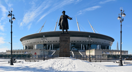 St Petersburg, Russia - March 26, 2018. Exterior view of St Petersburg stadium, with Kirov monument and street lamps. Stok Fotoğraf - 114382634