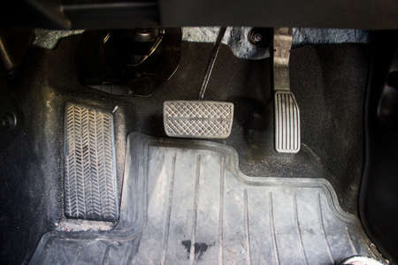 treadle: my car pedal quit dirty Stock Photo