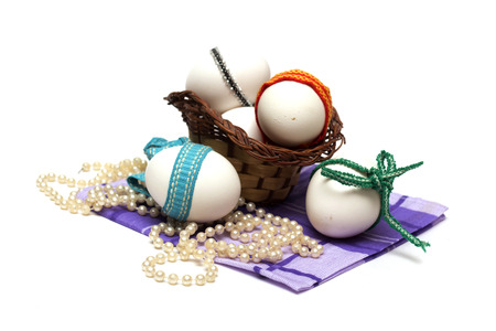 Easter holiday. Easter eggs with colored ribbon. Photo. photo
