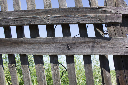 lattice frame: Wooden fence against the blue sky. Background. Stock Photo