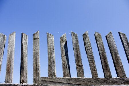 crossbar: Wooden fence against the blue sky. Background. Stock Photo