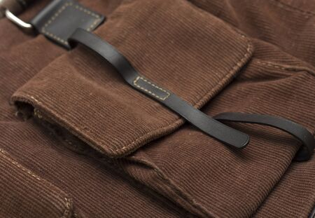 suede belt: Pocket with leather clasp on brown velvet bag. Photo.
