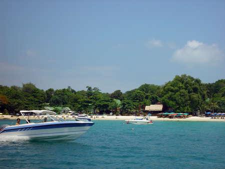 koh samet:   A speedboat close to a beach on the island Koh Samet in Thailand                              Stock Photo