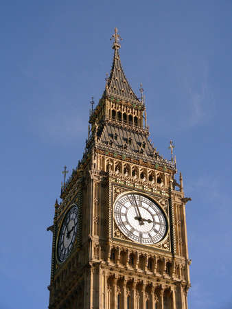 Close up of Big Ben which is a part of the Houses of Parliament in London next to River Thames                  photo