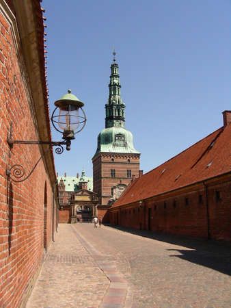A narrow street leading to the entrance to Frederiksborg Castle         photo