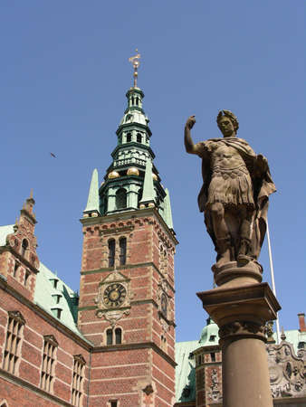 A statue in front of Frederiksborg Castle          photo