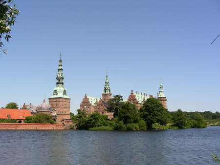 Frederiksborg Castle and the lake in front photo