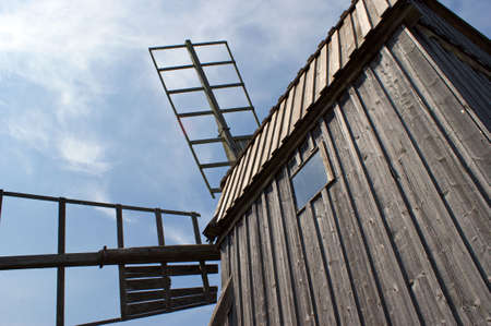 oland: Close up of a traditional post mill wooden windmill southern Oland Sweden on a summer day