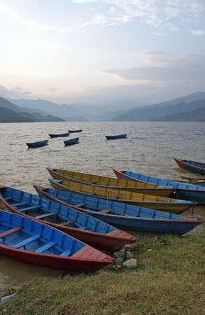 Lake Phewa Tal during the evening next to Pokhara in Nepal photo