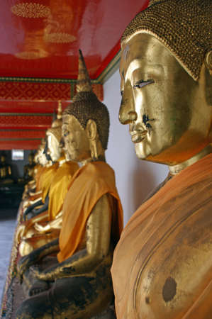 Buddha statues seen in Wat Pho also known as The Temple of the Reclining Buddha, is a Buddhist temple in Phra Nakhon district, Bangkok, Thailand. photo
