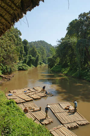 mai: Bamboo raft trip on the beautiful Ping River in the northern part of Thailand close to Chiang Mai Stock Photo