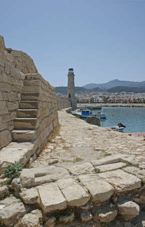 rethymno: The lighthouse and the old venetian port of Rethymno, Crete Stock Photo